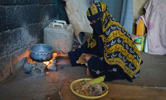 A woman in Aden, Yemen prepares food at a settlement for people who have fled their homes due to insecurity.
