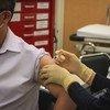 A man receives a COVID-19 vaccination in Macau, China.