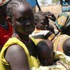In South Sudan, Nyalel Mayang, her husband and three children survived on water lilies and palm nuts for three months after their village was attacked.