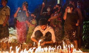 People in Yangon held a night vigil in defiance of curfew.