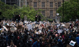 People protest in London in support of Black Lives Matter. June 2020.