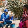 UN Zambia youth volunteers in Lusaka share information about coronavirus as part of community sensitisation efforts.