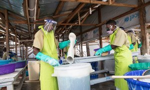 Staff at the Katwa Ebola treatment Unit in Butembo in the east of the Democratic Republic of the Congo disinfect boots and wash clothes. (August 2019)