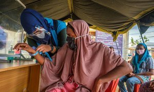 After a seven-month ordeal at sea, a Rohingya refugee is registered at a site in Aceh province, Indonesia.