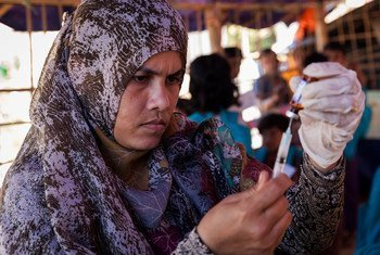 A health worker fills a syringe with vaccine at a Rohingya refugee camp in Cox's Bazar, Bangladesh.