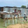 Despite rising waters, many families continue to live in their flood-affected homes in South Sudan's Jonglei State.
