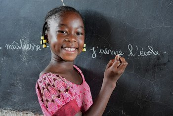 A girl writes on a blackboard at a school in Fada, eastern Burkina Faso, after returning to her class. Schools in the country had been closed for months due to COVID-19 mitigation measures.