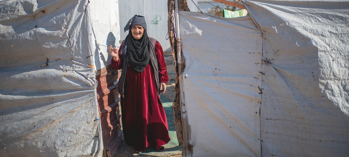 A 75-year-old Syrian woman living alone in a refugee camp where her husband passed away. Some of her children remain in Syria, while others are resettled in Europe.