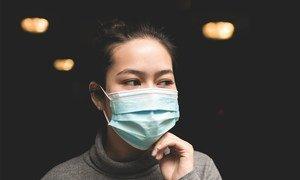 A women wearing a face mask.