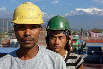Two workers on a construction site in Pokhara, Nepal.