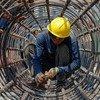Multinacionais cancelaram projetos de construção, como esta em Yangon, em Mianmar