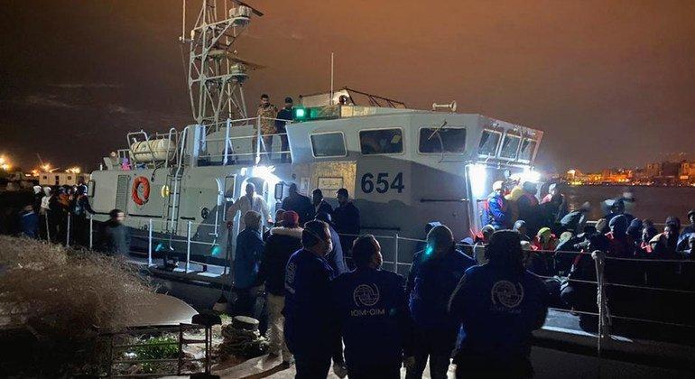 IOM Libya staff assist migrants at a disembarkation point in Tripoli, Libya.