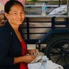 Sokkheng, who runs a village store in Cambodia, is supported by IIX's WLB1 (Women's Livelihood Bond 1).