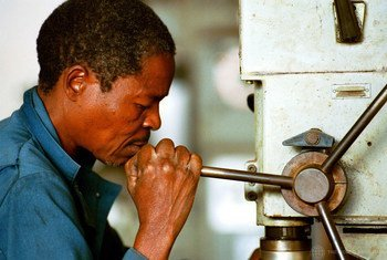Worker doing maintenance in Mozambique.