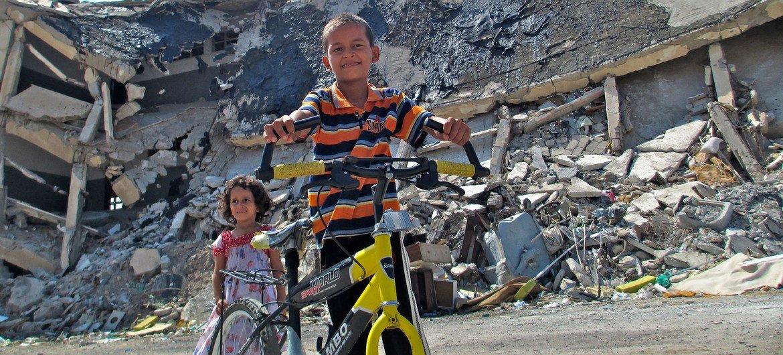 Children play near the ruins of Bab al-Azizia in Tripoli, Libya. (file)