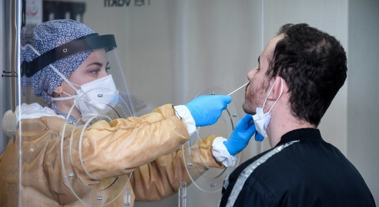 A healthcare worker at a testing facility collects samples for the coronavirus at Mimar Sinan State Hospital, Buyukcekmece district in Istanbul, Turkey.