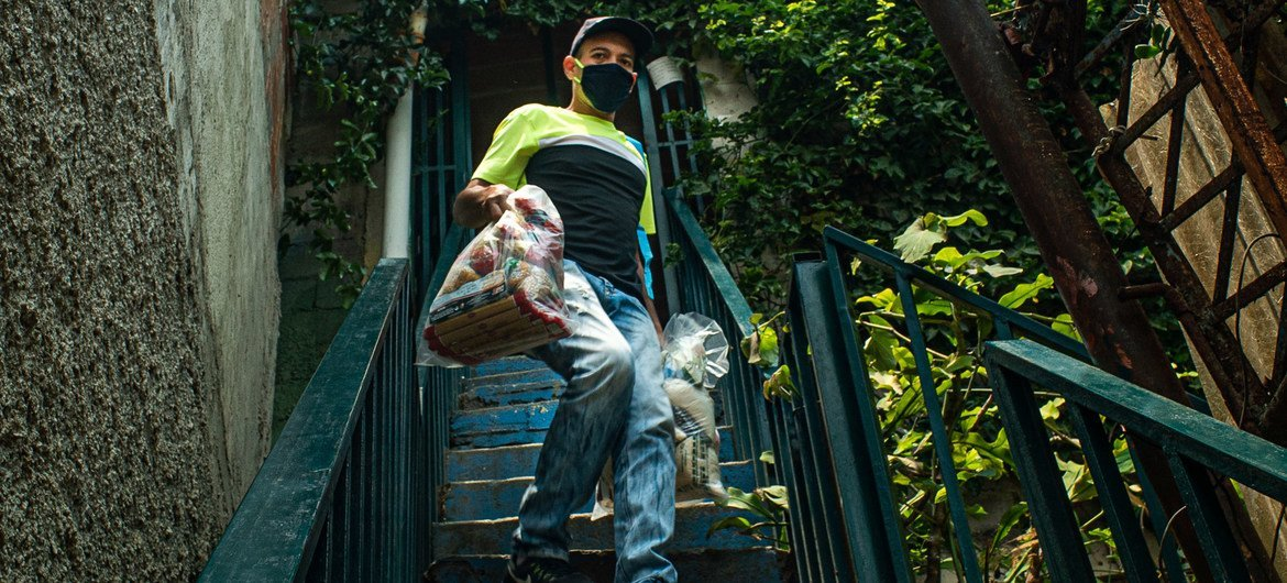 During the COVID-19 pandemic, food kits are delivered to prioritized communities in Venezuela.