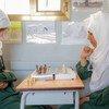 Teenage girls play chess at school in Sana'a, Yemen.