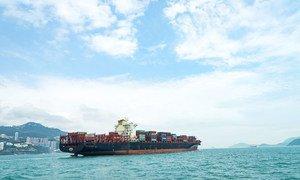 A containter ship sails near Hong Kong Island.