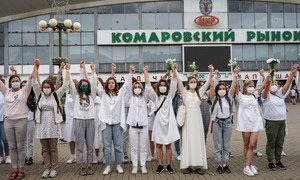 Women protesters hold hands in solidarity  over the disputed presidential election in Belarus.