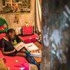 A primary school student studies at home in Kibera, Kenya.