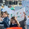 Students of the primary section of the Lycée français de New York (French School) protest climate change in the city's Upper East Side neighborhood.