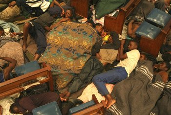 Zimbabwean men settle down for the night inside a church in central Johannesburg. The church provides shelter to Zimbabwean refugees. (file)