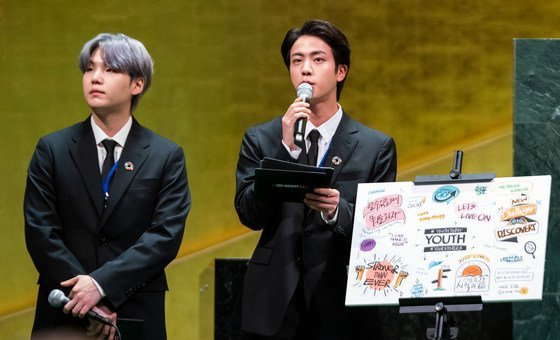 Members of the BTS K-Pop radical  enactment   successful  the SDG Moment successful  the UN General Assembly hall.