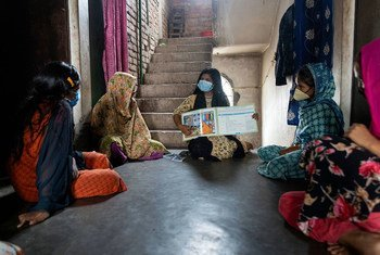 Adolescent girls attend a support group discussion on women's health.