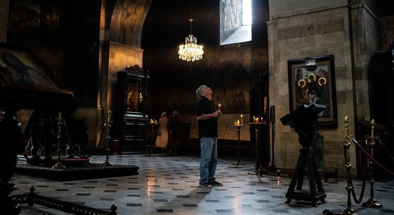 A man prays at Sioni Cathedral in central Tbilisi, Georgia.