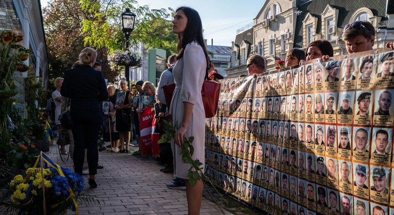 Halyna Yanchenko, one of Ukraine's youngest MPs, looks at a memorial for those who died during fighting in the east of Ukraine.
