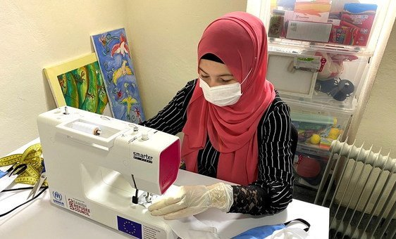 Refugees and migrants at reception centres in Bosnia are sewing masks for use by others at the centre.