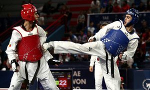 Refugee athlete Ehsan Naghibzadeh (R) in action during the 2019 Taekwondo G4 Extra European Championship