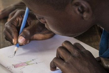 A  14 year-old former child soldier draws at a school in Ndenga village, Kaga Bandoro, Central African Republic. (file)