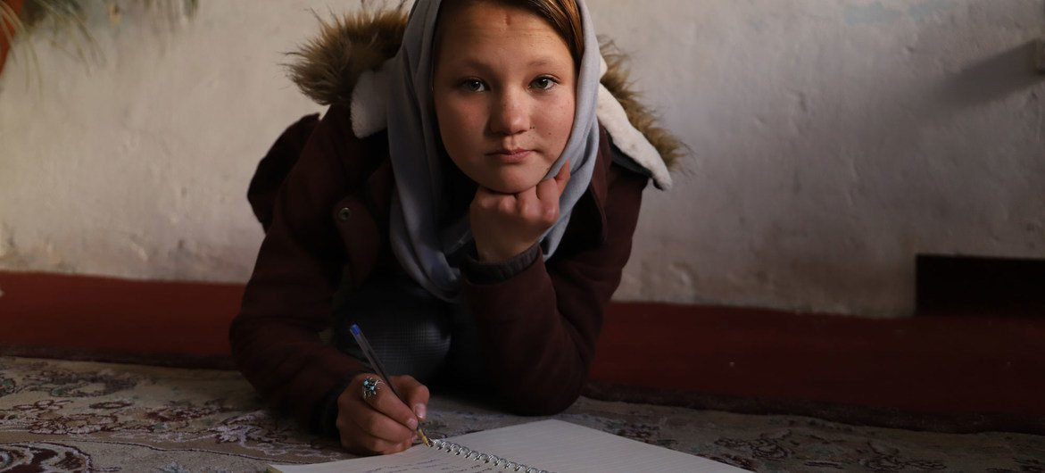 A young Afghan girl fled to Iran with her family and lived in  a refugee camp for five years before returning to Afghanistan.