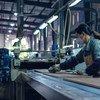 Trabajador de una fábrica en Zheijang, China