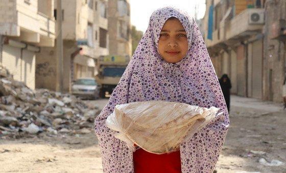 Criança em Alepo, na Síria, onde o conflito já dura há nove anos