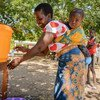 In Muona, Nsanje District (Southern Malawi) beneficiaries are asked to wash hands with soap before and after getting their entitlements.