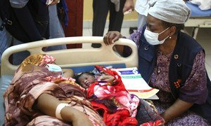UNFPA Executive Director Natalia Kanem (right) visits a mother and baby at a hospital maternity ward in Sudan's Blue Nile state.
