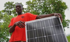 A young hairdresser will use the solar panel he received from the International Labour Organisation to power his salon in Malawi.
