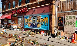 Tributes are left for George Floyd outside the grocery store in the US state of Minnesota where he was murdered by a police officer.