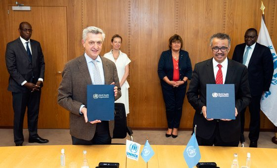 UN High Commissioner for Refugees Filippo Grandi (left) and Director-General, World Health Organization, Dr. Tedros Adhanom Ghebreyesus sign an agreement focused on the integration of refugees in national health preparedness and response plans.