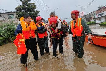 Emergency workers rescue an elderly person in Xuchang, in China's Henan Province.