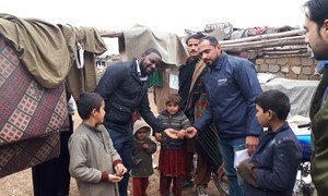 Dennis Chimenya (left) meets a family in Pakistan whose children have received the oral polio vaccine.