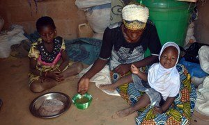 In Kaya, Burkina Faso, 27-year-old Mariam Sawadogo serves a meal to her family with food from the World Food Programme (WFP).