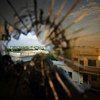 The skyline beyond the northern suburbs of Mogadishu is seen through a bullet hole in the window of a hotel in Somalia.