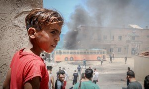 A Palestinian child in front of the Gaza port, which was damaged during the recent escalation.