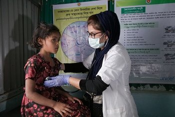 A medical assistant examines a seven-year-old girl in Cox's Bazar, Bangladesh.