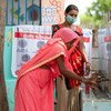 A woman in Gujarat, India, is educated on the benefits of handwashing during the COVID-19 pandemic.