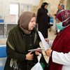 A health worker provides COVID-19 information to a patient visiting the Jerusalem Health Center.